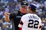 Umpire Bill Miller, left, talks with Chicago White Sox manager Tony La Russa during the seventh inning of the team's baseball game against the Houston Astros in Chicago, Sunday, July 18, 2021. (AP Photo/Nam Y. Huh)