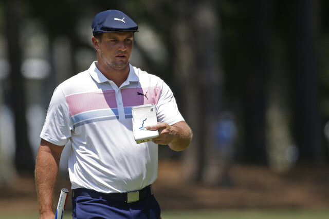 Bryson DeChambeau approaches the first green during the final round of the RBC Heritage golf tournament, Sunday, June 21, 2020, in Hilton Head Island, S.C. (AP Photo/Gerry Broome)