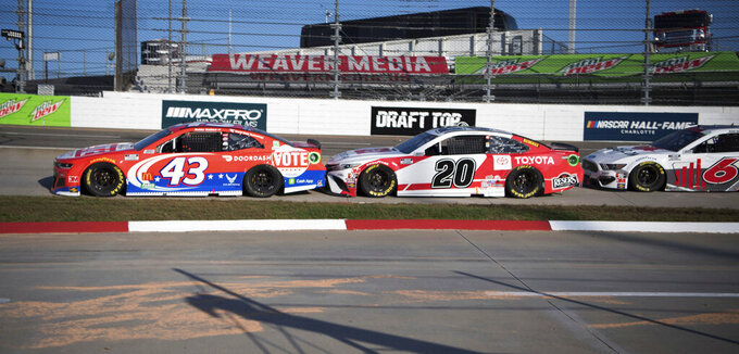 Bubba Wallace (43) gets bumped by Erik Jones (20) during a NASCAR Cup Series auto race at the Martinsville Speedway in Martinsville, Va., Sunday, Nov.1, 2020. (AP Photo/Lee Luther Jr.)