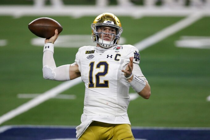 Notre Dame quarterback Ian Book (12) throws a pass in the first half of the Rose Bowl NCAA college football game against Alabama in Arlington, Texas, Friday, Jan. 1, 2021. (AP Photo/Roger Steinman)
