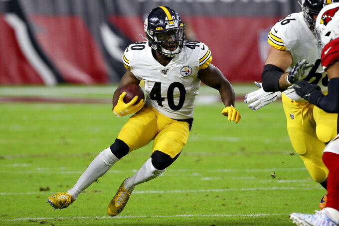 Pittsburgh Steelers running back Kerrith Whyte (40) runs against the Arizona Cardinals during the first half of an NFL football game, Sunday, Dec. 8, 2019, in Glendale, Ariz. (AP Photo/Ross D. Franklin)