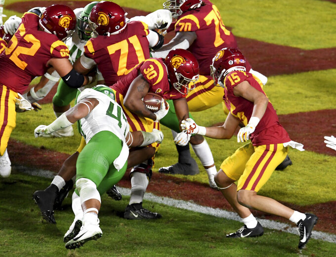 Running back Markese Stepp #30 of the USC Trojans runs for touchdown against the Oregon Ducks in the first half of the PAC 12 Championship football game at the Los Angeles Memorial Coliseum on Friday, December 18, 2020 in Los Angeles on Friday, December 18, 2020. (Keith Birmingham/The Orange County Register via AP)