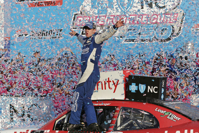 AJ Allmendinger celebrates in Victory Lane after winning a NASCAR Xfinity Series auto race at Charlotte Motor Speedway in Concord, N.C., Saturday, Sept. 28, 2019. (AP Photo/Gerry Broome)