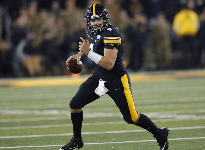 Iowa quarterback Nate Stanley runs the ball during the second half of an NCAA college football game against Minnesota, Saturday, Nov. 16, 2019, in Iowa City, Iowa. (AP Photo/Matthew Putney)