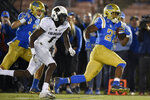 UCLA running back Joshua Kelley, right, runs for a touchdown past Colorado cornerback Delrick Abrams Jr., center, during the second half of an NCAA college football game as Ethan Fernea follows the play in Los Angeles, Saturday, Nov. 2, 2019. UCLA won 31-14. (AP Photo/Kelvin Kuo)