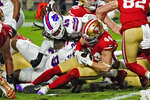 San Francisco 49ers fullback Kyle Juszczyk (44) is stopped short of the goal line by Buffalo Bills middle linebacker Tremaine Edmunds (49) during the first half of an NFL football game, Monday, Dec. 7, 2020, in Glendale, Ariz. (AP Photo/Rick Scuteri)