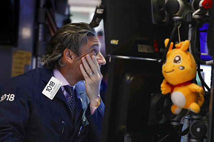 FILE - In this May 29, 2019, file photo trader John Romolo works on the floor of the New York Stock Exchange. It may seem like the market should take off once all the trade-war worries dissipate. But investors have a long list of worries that have nothing to do with tariffs. Not only are profit margins weakening, reports showed weakening economic trends around the world for April, which was before President Trump shattered the market's calm with his tariff tweets. (AP Photo/Richard Drew, File)