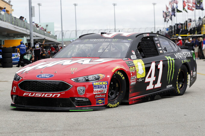 Kurt Busch leaves the garage during practice for the NASCAR Cup Series auto race at the Homestead-Miami Speedway, Saturday, Nov. 17, 2018, in Homestead, Fla. (AP Photo/Lynne Sladky)