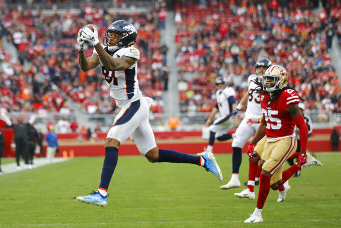 FILE - In this Dec. 9, 2018, file photo, Denver Broncos wide receiver Tim Patrick catches a pass as San Francisco 49ers cornerback Richard Sherman (25) looks on during the second half of an NFL football game in Santa Clara, Calif. Patrick who broke his left hand in the opener at Oakland after playing just eight snaps on offense and nine on special teams, is expected to return to the 53-man roster this weekend. (AP Photo/Josie Lepe, File)