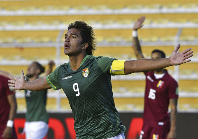 Bolivia's Marcelo Martins celebrates after scoring his team's third goal against Venezuela during a World Cup qualifying soccer match in La Paz, Bolivia, Thursday, June 3, 2021. (Aizar Raldes/Pool via AP)