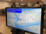 In this Tuesday, Feb. 6, 2018, photo a monitor shows post 2014 Airspace Change Departure Tracks of airplane flight paths from the Phoenix Sky Harbor airport during one of several area workshops organized by the FAA to reach out to residents held at the Maryvale High School cafeteria in Phoenix. More than three years after waking up to find window-rattling flights rerouted over their homes in an airborne highway, residents of Phoenix's historic downtown districts said they finally felt the FAA was listening to them. (AP Photo/Anita Snow)