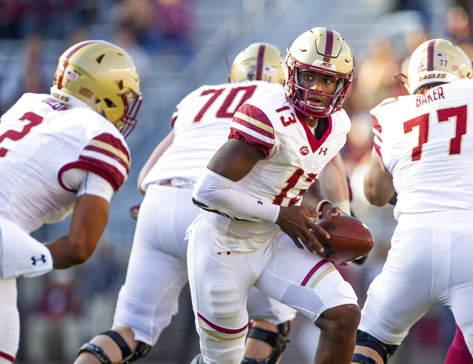 Boston College quarterback Anthony Brown prepares to hand off to running back AJ Dillon in the first half of an NCAA college football game against Florida State in Tallahassee, Fla., Saturday, Nov. 17, 2018. (AP Photo/Mark Wallheiser)