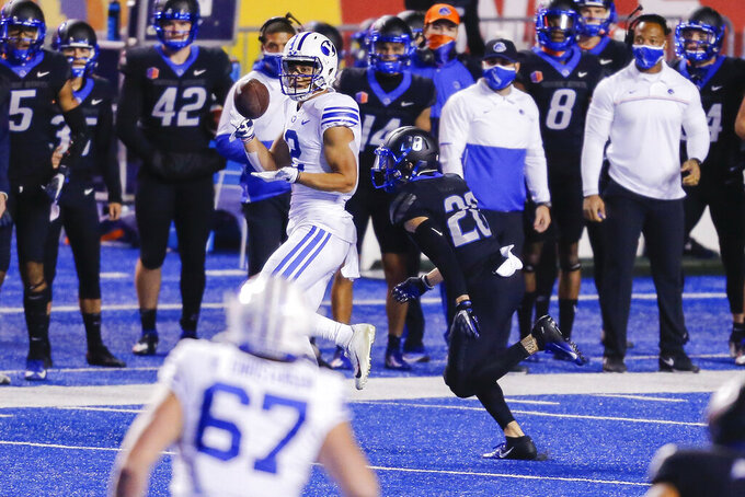 BYU wide receiver Neil Pau'u (2) turns back for the ball in front of Boise State guard Kekaula Kaniho (28) during the first half of an NCAA college football game Friday, Nov. 6, 2020, in Boise, Idaho. (AP Photo/Steve Conner)