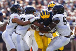 Army defenders stop Michigan running back Zach Charbonnet (24) in the second half of an NCAA college football game in Ann Arbor, Mich., Saturday, Sept. 7, 2019. Michigan won 24-21 in overtime. (AP Photo/Paul Sancya)