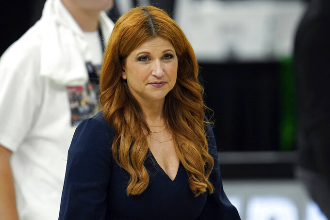"""FILE - In this July 20, 2021, file photo, ESPN reporter Rachel Nichols walks on the court after Game 6 of basketball's NBA Finals between the Milwaukee Bucks and Phoenix Suns in Milwaukee. ESPN is cancelling Nichols' """"The Jump"""" show and pulling her off NBA programming. (AP Photo/Paul Sancya, File)"""