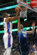 Philadelphia 76ers center Al Horford, left, shoots in front of Dallas Mavericks forward Maxi Kleber, right, during the first half of an NBA basketball game in Dallas, Saturday, Jan 11, 2020. (AP Photo/Michael Ainsworth)