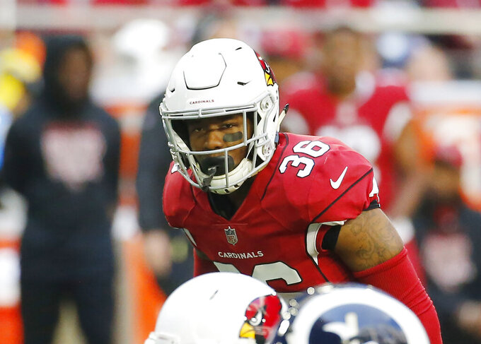 FILE - In this Sunday, Dec. 23, 2018 file photo, Arizona Cardinals strong safety Budda Baker (36) looks toward the quarterback during the first half of an NFL football game against the Los Angeles Rams in Glendale, Ariz. The Cardinals locker room was a jovial place on Tuesday, Nov. 19, 2019, with players rushing through their post-practice routine so they could embark on a five-day break away from football. Arizona safety Budda Baker hopes he and his defensive teammates have fun before coming back to the desert with better energy and focus. (AP Photo/Rick Scuteri, File)