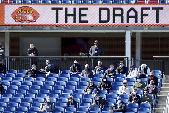 NFL team personnel watch the National team practice for the NCAA college football Senior Bowl in Mobile, Ala., Thursday, Jan. 28, 2021. (AP Photo/Rusty Costanza)