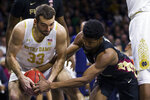 Notre Dame's John Mooney (33) competes for control of the ball with Florida State's Malik Osborne during the first half of an NCAA college basketball game Wednesday, March 4, 2020, in South Bend, Ind. (AP Photo/Robert Franklin)