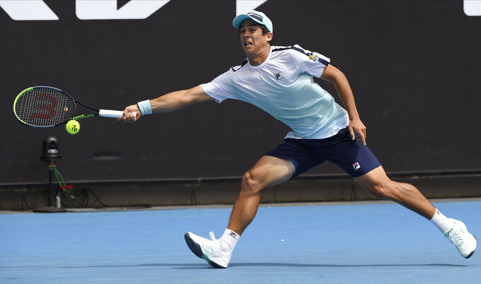 United States' Mackenzie McDonald hits a backhand return to South Africa's Lloyd Harris during their third round match at the Australian Open tennis championship in Melbourne, Australia, Saturday, Feb. 13, 2021.(AP Photo/Andy Brownbill)