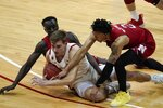 Wisconsin's Tyler Wahl goes after a loose ball with Nebraska's Lat Mayen and Trey McGowens (2) during the second half of an NCAA college basketball game Tuesday, Dec. 22, 2020, in Madison, Wis. (AP Photo/Morry Gash)