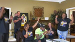 In this still image from video provided by the NFL, Patrick Queen, seated at front center, reacts along with others after being selected in the first round by the Baltimore Ravens during the NFL football draft Thursday, April 23, 2020, in Ventress, La. (NFL via AP)