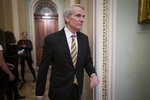 FILE - In this Jan. 31, 2020, file photo Sen. Rob Portman, R-Ohio, arrives as the impeachment trial of President Donald Trump on charges of abuse of power and obstruction of Congress resumes in Washington. Pressure is increasing on a Trump administration official to authorize a formal transition process for President-elect Joe Biden. Portman of Ohio on Monday, Nov. 23, called for the head of the General Services Administration to release money and staffing needed for the transition. (AP Photo/J. Scott Applewhite, File)