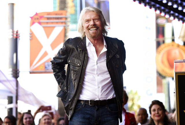 FILE - In this Oct. 16, 2018 file photo, Richard Branson appears at a ceremony honoring him with a star on the Hollywood Walk of Fame, in Los Angeles.  Virgin Hyperloop One will build a certification center in West Virginia to test the high-speed transportation concept that uses enclosed pods to zip passengers underground at over 600 mph (966 kph).   The company had received bids from 17 states in 2020 to build a 6-mile testing track and other facilities over hundreds of acres for its electromagnetic levitation transportation technology.  (Photo by Chris Pizzello/Invision/AP File)