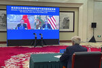 In this photo provided by the U.S. Department of State, U.S. Special Presidential Envoy for Climate John Kerry attends a meeting with Yang Jiechi, Director of China's Office of the Central Commission for Foreign Affairs via video link in Tianjin, China, Thursday, Sept. 2, 2021. (U.S. Department of State via AP)
