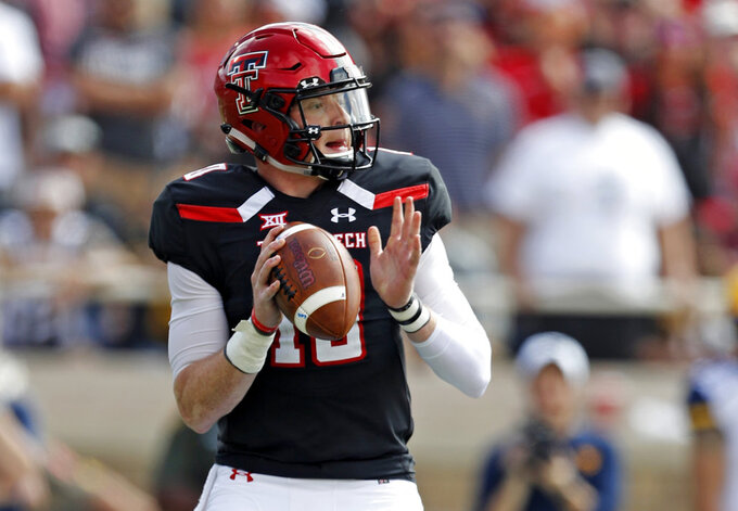 FILE - In this Saturday, Sept. 29, 2018, file photo, Texas Tech's Alan Bowman (10) drops back to pass during the first half of an NCAA college football game against West Virginia in Lubbock, Texas. Bowman was the nation's top passer before a crushing blow against West Virginia left him with a partially collapsed lung and led to a short hospital stay. But Kingsbury said Bowman could be available to play Thursday against TCU.  (AP Photo/Brad Tollefson, File)