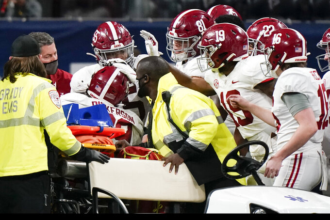 Alabama offensive lineman Landon Dickerson (69) leaves the field with teammates speaking during the second half of the Southeastern Conference championship NCAA college football game against Florida, Saturday, Dec. 19, 2020, in Atlanta. (AP Photo/Brynn Anderson)