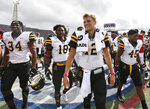 Appalachian State quarterback Zac Thomas (12) leads his team off the field after a win over South Alabama in an NCAA college football game Saturday, Oct. 26, 2019, at Ladd-Peebles Stadium in Mobile, Ala. (AP Photo/Julie Bennett)
