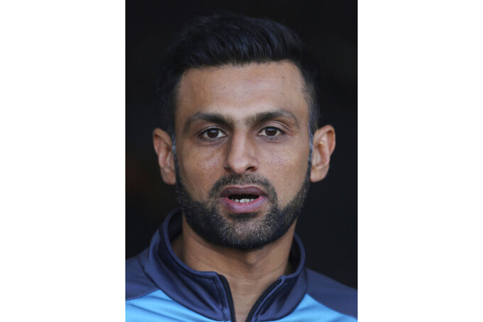 FILE - In this  Jan. 22, 2020, file photo, Pakistan allrounder Shoaib Malik gestures addresses a press conference in Lahore, Pakistan. Malik, who will be playing in the Twenty20s, has been given special dispensation by the PCB to join the team in England on July 24 after spending time with his family. The Pakistan cricket squad will leave for England on June 28 to play three tests and three Twenty20s internationals, the PCB confirmed on Saturday, June 20, 2020. (AP Photo/K.M. Chaudary, File)