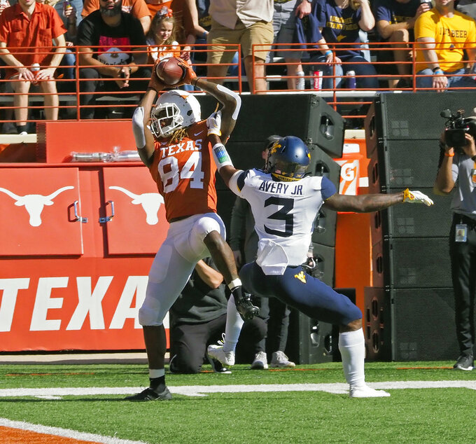 Texas received Lil'Jordan Humphrey (84) catches the ball at the one-yard line against West Virginia defensive back Toyous Avery, Jr. (3) during the first half of an NCAA college football game, Saturday, Nov. 3, 2018, in Austin, Texas. (AP Photo/Michael Thomas)
