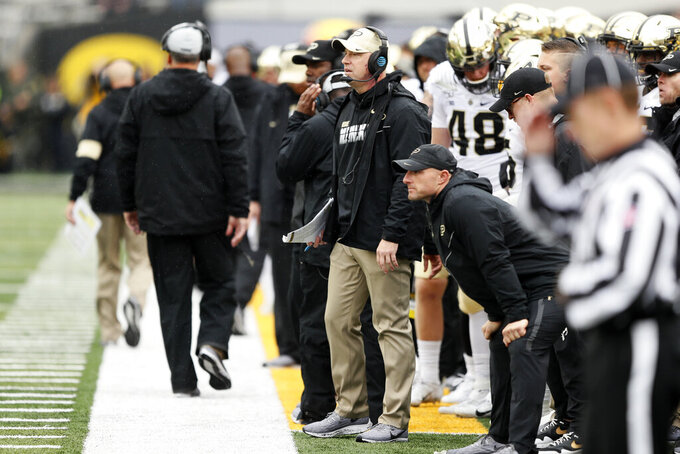 Purdue head coach Jeff Brohm, center, watches from the sideline during the second half of an NCAA college football game against Iowa, Saturday, Oct. 19, 2019, in Iowa City, Iowa. Iowa won 26-20. (AP Photo/Charlie Neibergall)