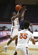 Virginia Tech's Jalen Cone (15) shoots a three-point basket against Longwood in the first half of an NCAA college basketball game in Blacksburg, Va., Monday, Dec. 21, 2020. (Matt Gentry/The Roanoke Times via AP, Pool)