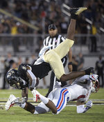 UCF wide receiver Dredrick Snelson is upended by SMU safety Mikial Onu (4) after catching a pass during the first half of an NCAA college football game Saturday, Oct. 6, 2018, in Orlando, Fla. (AP Photo/Phelan M. Ebenhack)
