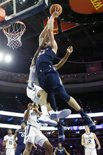 Xavier's Zach Hankins, right, goes up for a shot against Villanova's Jermaine Samuels during the first half of an NCAA college basketball game Friday, Jan. 18, 2019, in Philadelphia. (AP Photo/Matt Slocum)
