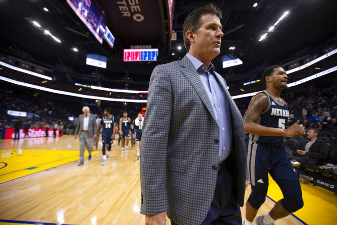 Nevada head coach Steve Alford walks off the court at the end of the first half of an NCAA college basketball game against Saint Mary's on Saturday, Dec. 21, 2019, in San Francisco. (AP Photo/D. Ross Cameron)