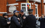 Armed police arrive outside the Ecuadorian Embassy, in London, Friday, April 5, 2019, where Wikileaks founder Julian Assange has been holed up since 2012, as a van with a Free Assange placard had parked illegally on a diplomatic spot outside the Embassy. A senior Ecuadorian official said no decision has been made to expel Julian Assange from the country's London embassy despite tweets from Wikileaks that sources had told it he could be kicked out within