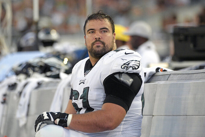 FILE - In this Aug. 15, 2019, file photo, then Philadelphia Eagles offensive guard Stefen Wisniewski (61) watches from the bench during the first half of an NFL preseason football game against the Jacksonville Jaguars, in Jacksonville, Fla. The Pittsburgh Steelers officially signed the well-traveled Wisniewski to a two-year deal on Wednesday, March 25, 2020, bringing the veteran offensive lineman to his hometown. (AP Photo/Phelan M. Ebenhack, File)