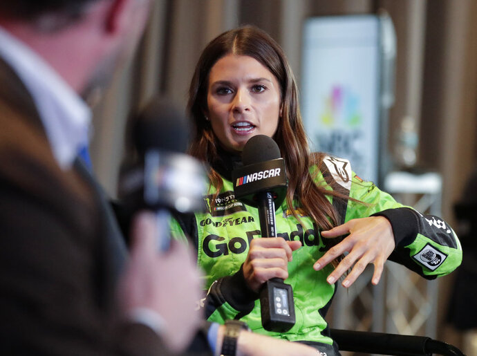 Danica Patrick answer questions during an interview during media day for the NASCAR Daytona 500 auto race at Daytona International Speedway, Wednesday, Feb. 14, 2018, in Daytona Beach, Fla. (AP Photo/John Raoux)