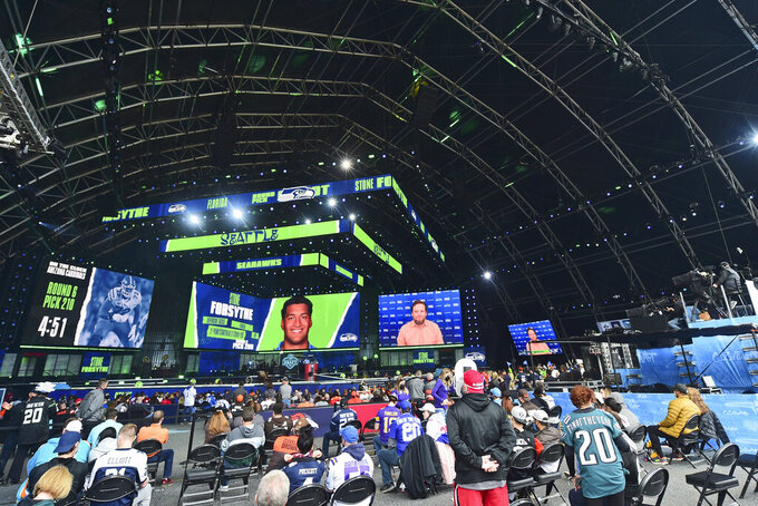 Seattle Seahawks pick Stone Forsythe, offensive tackle from Florida, is displayed in The Draft Theatre during the sixth round of the NFL football draft, Saturday, May 1, 2021, in Cleveland. (AP Photo/David Dermer)