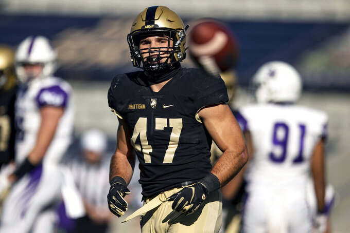 In this Oct. 3, 2020, photo provided by Army Athletics, Army senior linebacker Jon Rhattigan (47) is shown during the second half of an NCAA college football game against Abilene Christian in West Point, N.Y. This season is his first year starting and he leads the Black Knights in tackles and is one of 18 semifinalists nationally for the Bednarik Award, given to the outstanding defensive player of the year in the nation. (Dustin Satloff/Army Athletics via AP)