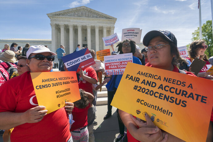 Immigration activists rally outside the Supreme Court as the justices hear arguments over the Trump administration's plan to ask about citizenship on the 2020 census, in Washington, Tuesday, April 23, 2019. Critics say the citizenship question on the census will inhibit responses from immigrant-heavy communities that are worried the information will be used to target them for possible deportation. (AP Photo/J. Scott Applewhite)