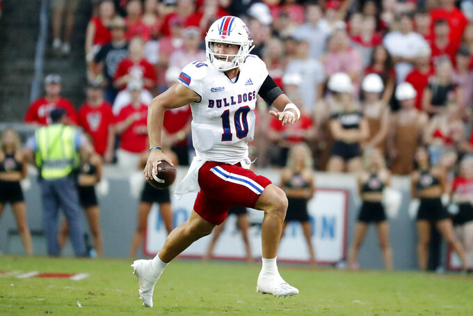 Louisiana Tech's Austin Kendall (10) rushes the ball against North Carolina State during the first half of an NCAA college football game in Raleigh, N.C., Saturday, Oct. 2, 2021. (AP Photo/Karl B DeBlaker)