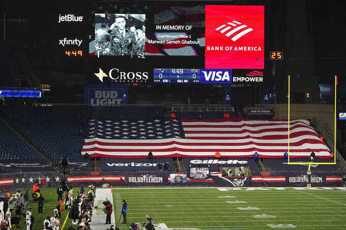 U.S. Army Chief Warrant Officer 2 Marwan Sameh Ghabour, of Arlington, Mass., who died in a helicopter crash in Egypt on Thursday, is honored on the video screen at Gillette Stadium before an NFL football game between the Baltimore Ravens and the New England Patriots, Sunday, Nov. 15, 2020, in Foxborough, Mass. (AP Photo/Charles Krupa)