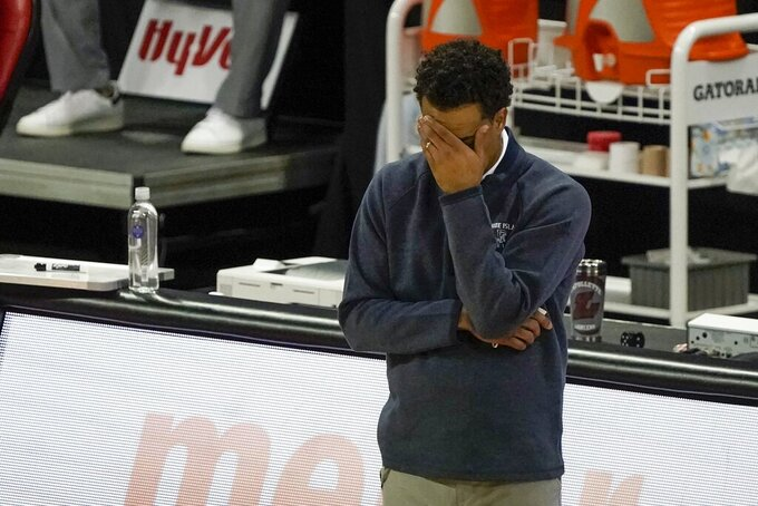 Rhode Island head coach David Cox reacts during the second half of an NCAA college basketball game against Wisconsin Wednesday, Dec. 9, 2020, in Madison, Wis. (AP Photo/Morry Gash)