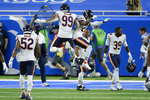 Chicago Bears' Trevis Gipson (99) and Sherrick McManis (27) celebrate their 27-23 win against the Detroit Lions after an NFL football game in Detroit, Sunday, Sept. 13, 2020. (AP Photo/Duane Burleson)