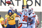 West Virginia defensive lineman Dante Stills (55) and Oklahoma State quarterback Shane Illingworth (16) watch as Oklahoma State running back Chuba Hubbard (30) tries to catch a bad snap during an NCAA college football game Saturday, Sept. 26, 2020, in Stillwater, Okla. (AP Photo/Brody Schmidt)